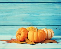 45342104 - pumpkins and autumn leafs over turquoise wood