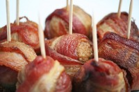 7498390 - bacon wrapped meatballs with toothpicks on white